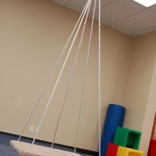 Platform swing for motor and sensory therapy.